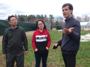 Dobson with researchers Dr. Jim Tang and his assistant at Equinox Farm.