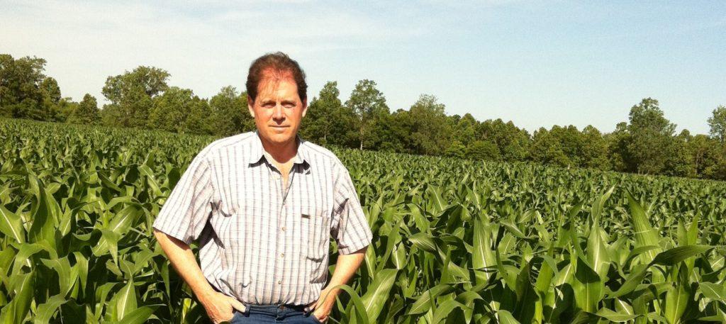 David Munson standing in a cornfield.