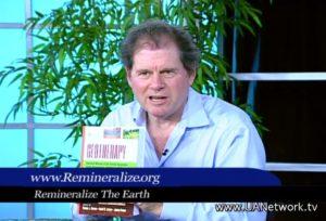 Screen shot of David Munson holding RTE's book on his UAN television program.