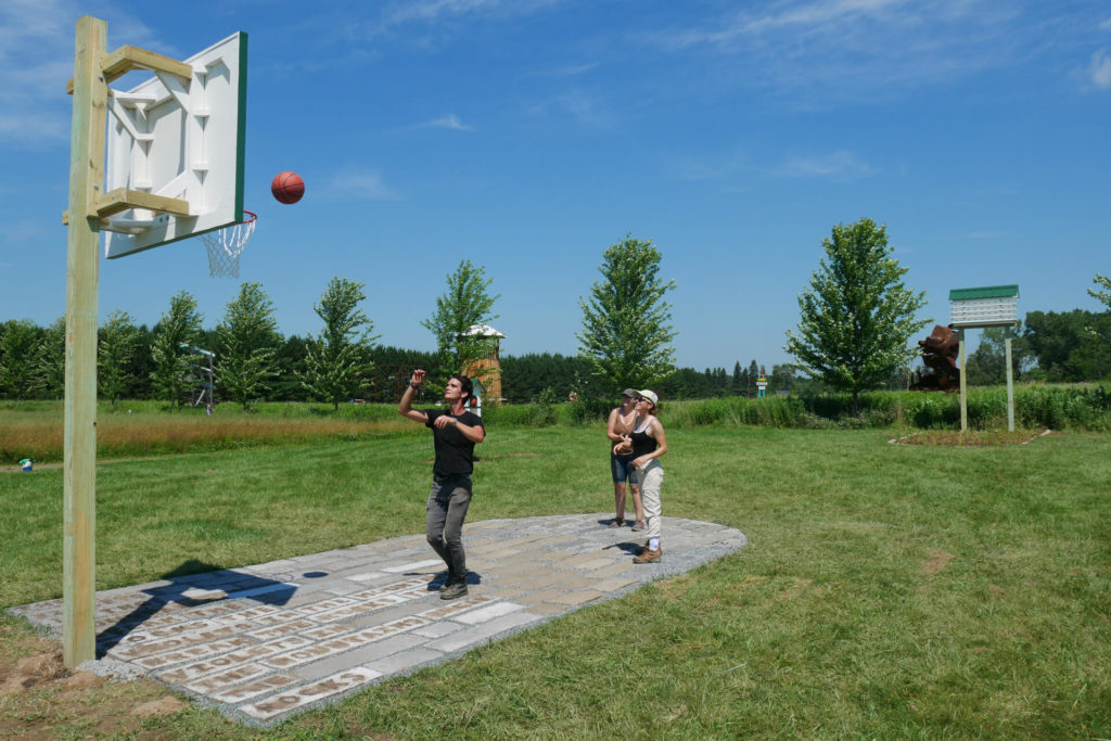 Members of Kosmologym playing basketball in the Dirtball installation