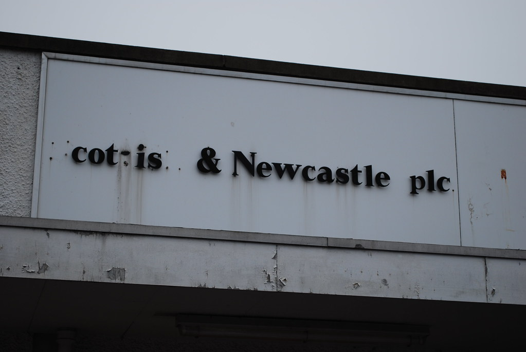Crumbling sign on the old Scottish & Newcastle plc building