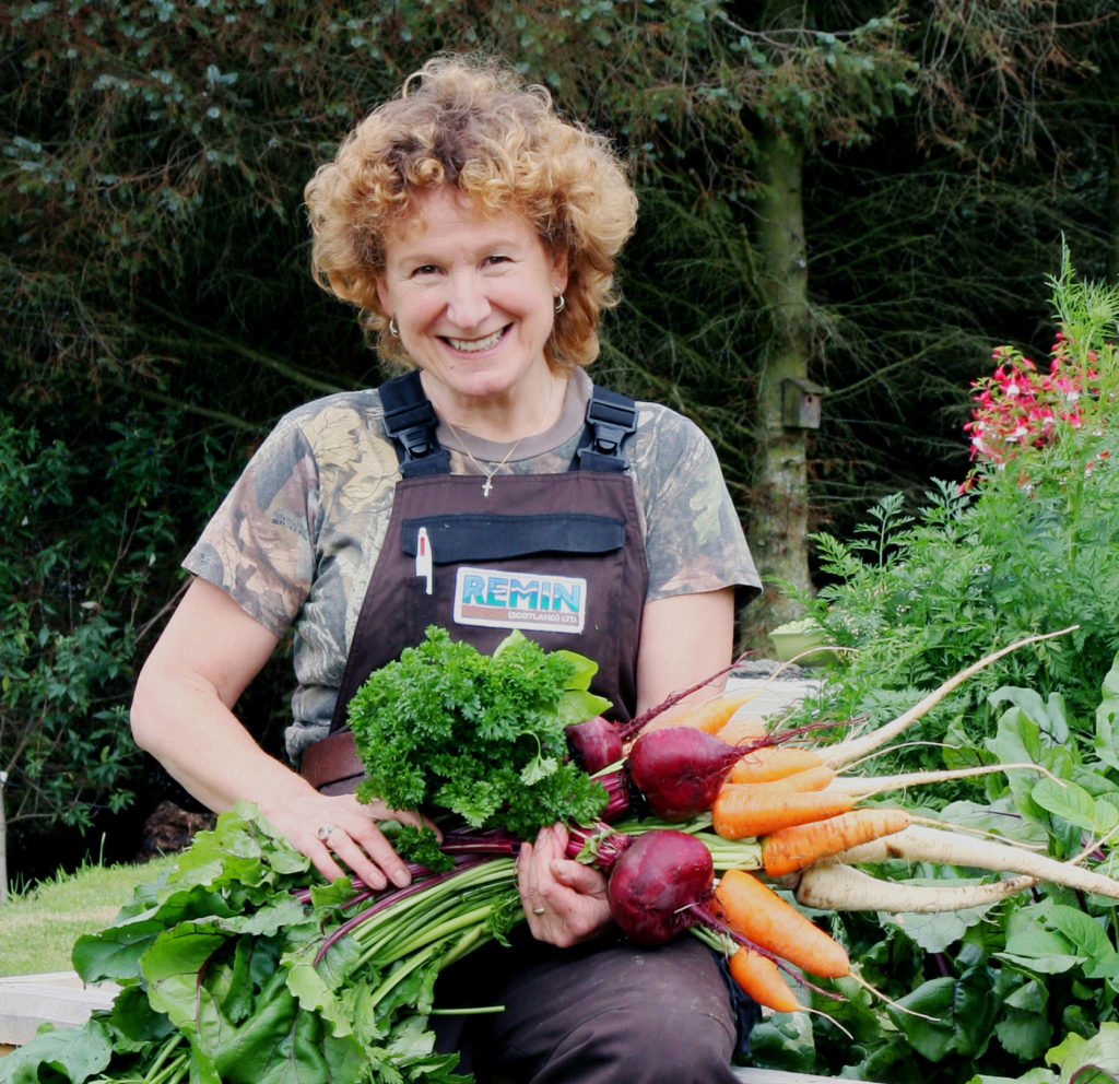 Jennifer Brodie with vegetables grown using REMIN
